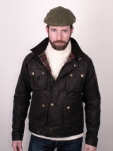 Man in motoring jacket and flat cap