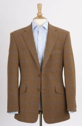 A two buttoned tweed sports jacket